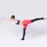 Woman balancing while, yoga poses Stock Image