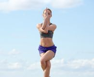 Woman balancing in yoga position outdoors Royalty Free Stock Photo