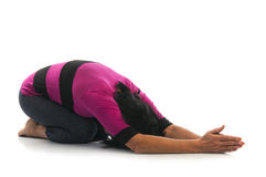 Woman in Balasana yoga pose Stock Photography