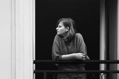 Woman at balcony Stock Photography