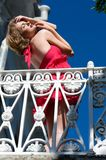 Woman on the balcony. bottom view Stock Photos