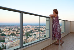 Woman on a balcony in downtown Stock Photography