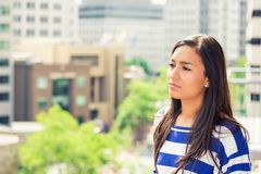 Woman on the balcony enjoying city view relaxing. Portrait young woman on the balcony enjoying city view relaxing stock image