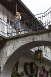 Woman on the balcony of an old house in the Jewish quarter. Stock Photography