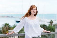 Woman on a balcony overlooking the sea Stock Photography