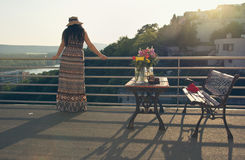 Woman at Balcony in Sunset Stock Photography