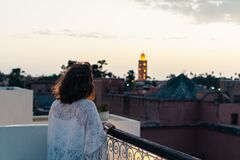 Woman on balcony at twilight Royalty Free Stock Photo