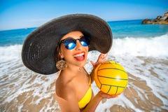 Woman with ball on the beach Stock Photos