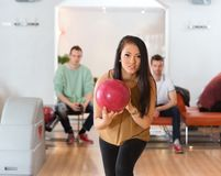 Woman With Ball Bowling in Club Royalty Free Stock Image