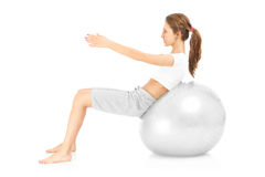 Woman and ball sit ups Royalty Free Stock Photo