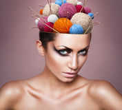 Woman with ball of threads in head Royalty Free Stock Images