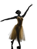Woman ballerina ballet dancer dancing silhouette. One woman ballerina ballet dancer dancing in silhouette on white background royalty free stock images