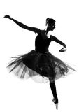 Woman ballet dancer leap dancing silhouette. One beautiful caucasian woman ballet dancer dancing leap jumping full length on studio isolated white background Royalty Free Stock Photo