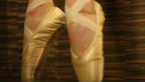 Woman in ballet shoes standing en pointe stock video footage