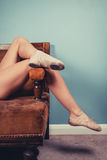 Woman in ballet slippers on sofa Royalty Free Stock Photo