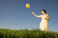 Woman with ballon Stock Photos