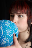 Woman&ballon. The young woman inflates a blue balloon stock photo
