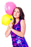 Woman with ballons. In studio isolated on white stock images