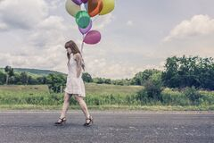 Woman with ballons