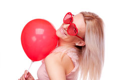 Woman with balloon and heart-shape glasses Royalty Free Stock Photos