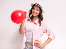 Woman with balloon Stock Images