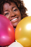 Woman with balloons. Is smiling Royalty Free Stock Image