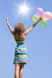 Woman with balloons Royalty Free Stock Image