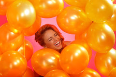 Woman in a balloons. Portrait of cheerful young woman in a balloons frame Stock Image