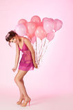 Woman with balloons Stock Image