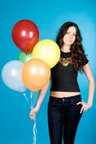 Woman with balloons. Attractive young woman stood with colorful balloons, blue background Stock Photos