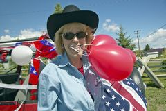 Woman with balloons and decorated red, white and blue car in Lima Montana Stock Images