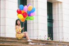 Woman with balloons in hands royalty free stock photo