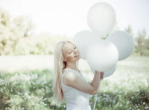 Woman with balloons Stock Photography