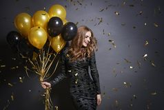 Woman with balloons. Joyful woman with bunch of balloons stock photography