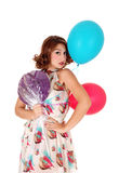 Woman with balloons and lollipop. Stock Photography