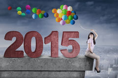 Woman with balloons and number 2015 Stock Photography