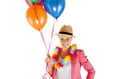 Woman with balloons over white background smiling Stock Image