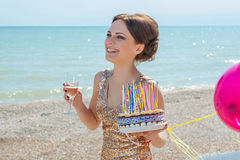 Woman with balloons on the sea Stock Photo