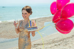 Woman with balloons on the sea Stock Images