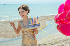 Woman with balloons on the sea Royalty Free Stock Image