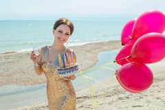Woman with balloons on the sea Stock Image