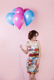 Woman with balloons Stock Images