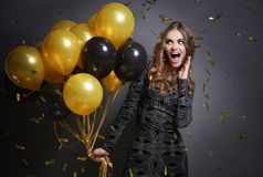 Woman with balloons. Woman giving a cheer for new year royalty free stock image