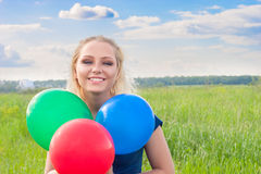 Woman with balloons Royalty Free Stock Images