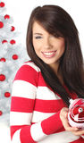 Woman with balls next to christmas tree Stock Photos