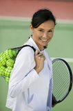 Woman With Balls And Racquet On Tennis Court Stock Photos