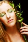 Woman with bamboo Stock Photos