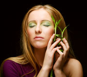 Woman with bamboo Stock Photography