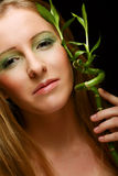 Woman with bamboo Royalty Free Stock Image