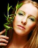 Woman with bamboo Royalty Free Stock Photos